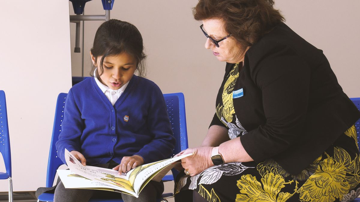 Volunteers play a vital role in helping children to improve their reading skills