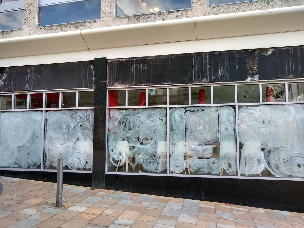 KFC with its windows covered and signs removed after its shut this week