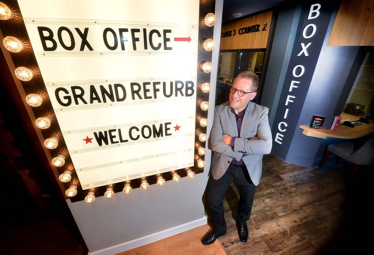 Adrian Jackson with the new box office following the Grand Theatre's refurbishment