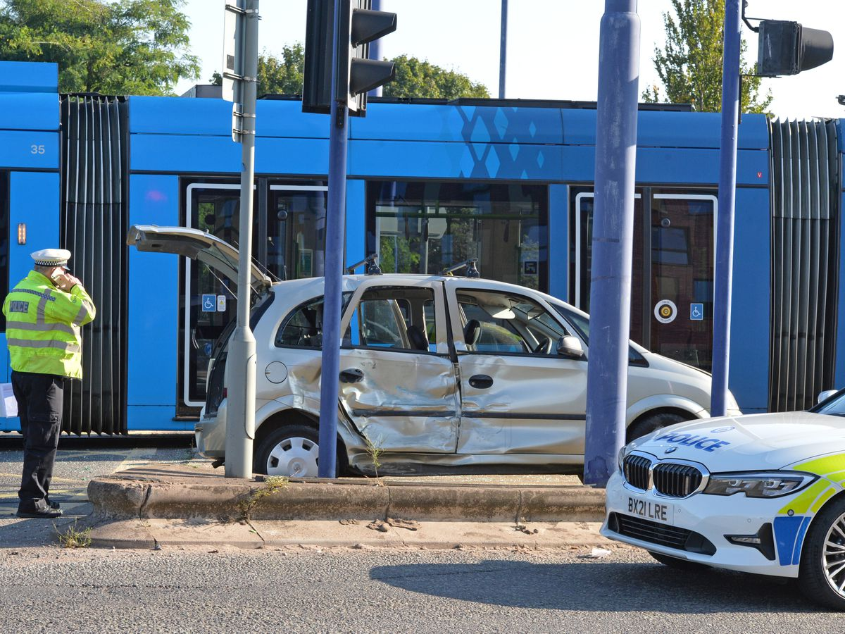 Two teenagers were in a Vauxhall car when it crashed into a tram