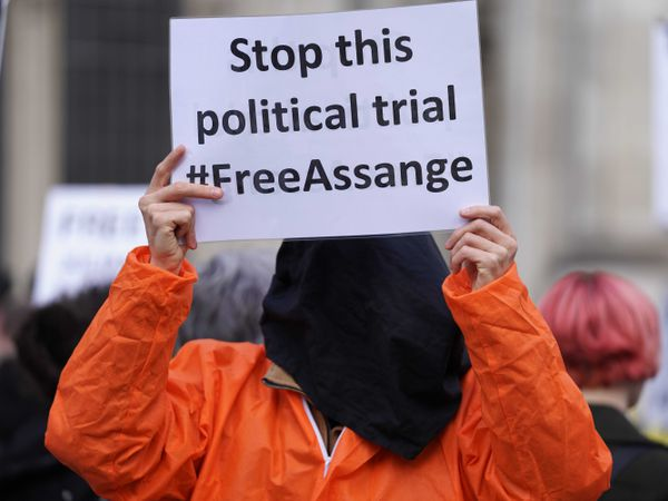 A protester outside the High Court in London, ahead of a hearing in the US government's legal challenge over a judge's decision not to extradite Wikileaks founder Julian Assange (Kirsty O'Connor/PA)