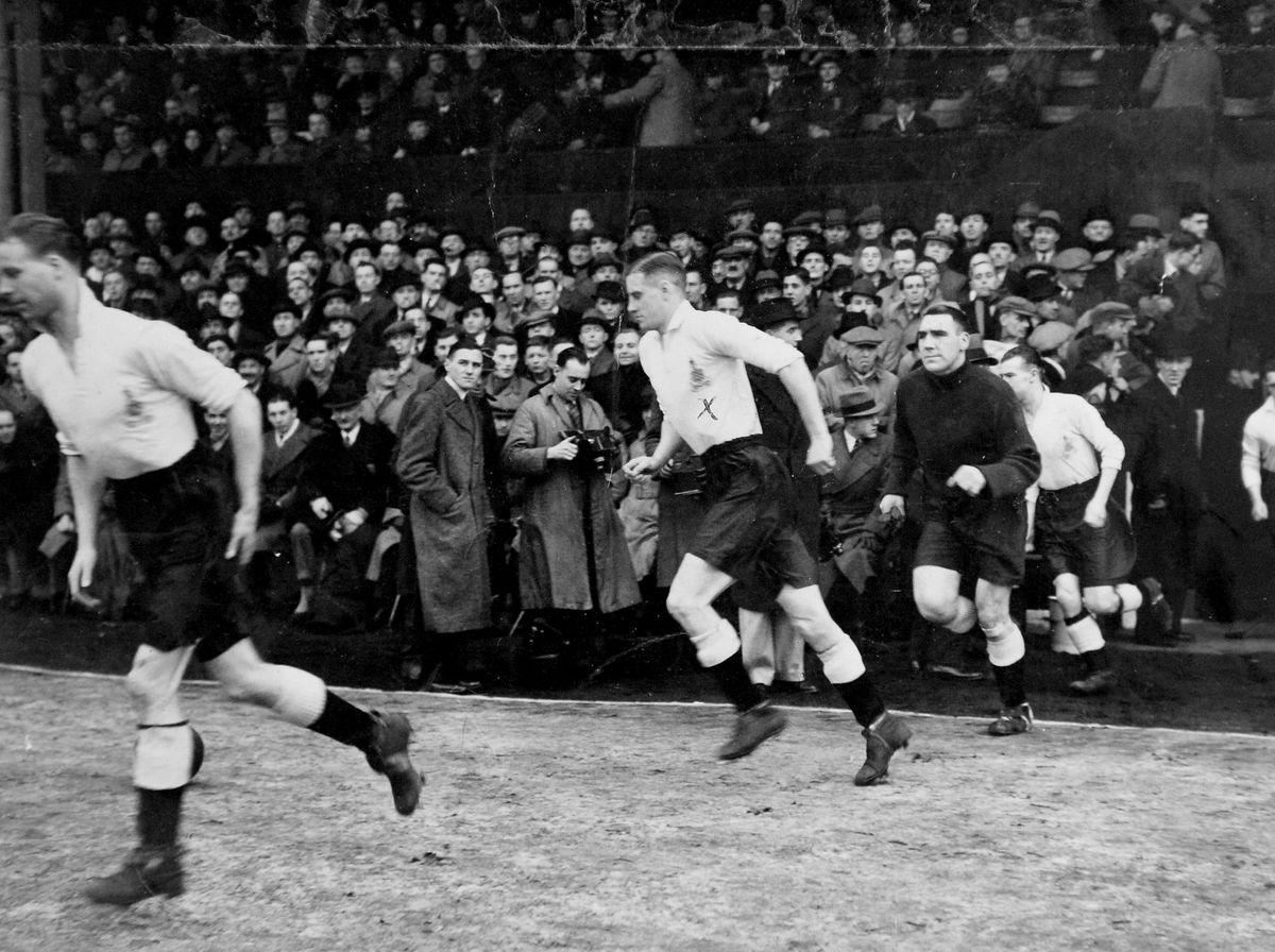 Footballing hero Tom, pictured in the centre, made three appearances for England