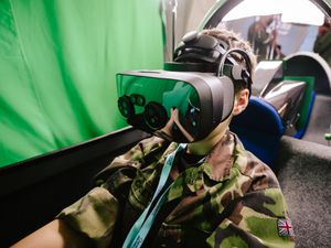 One of the air cadets wearing a virtual reality headset