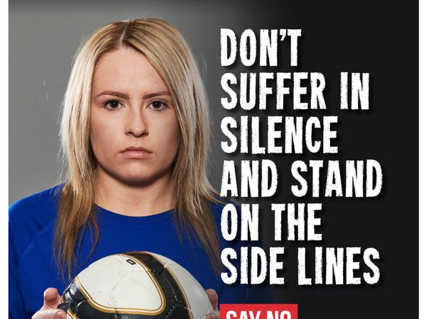 Football fans have been urged to show domestic violence the red card