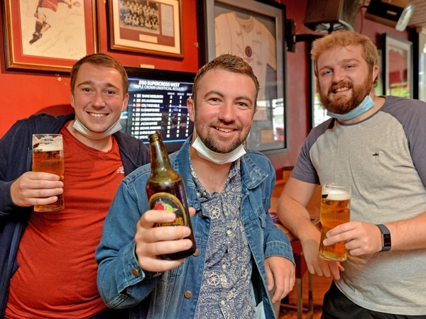 Pints poured and hair trimmed again as lockdown eased