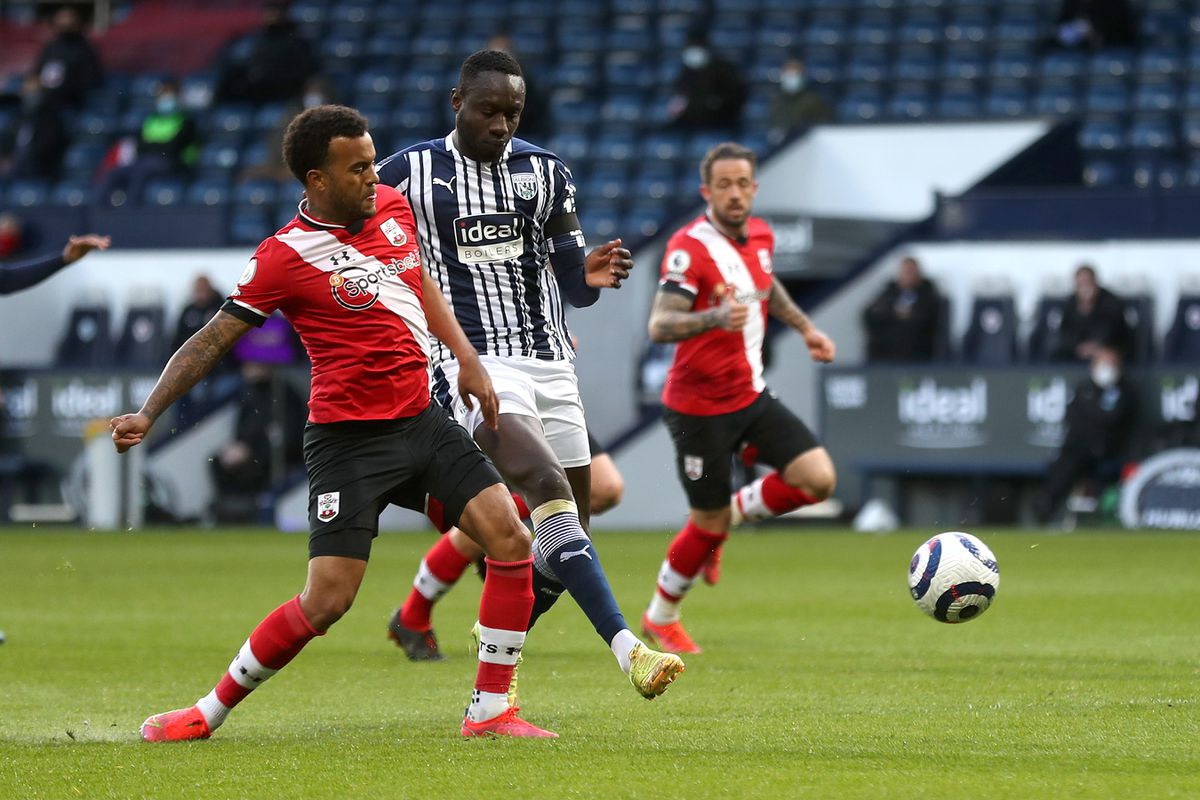 Mbaye Diagne of West Bromwich Albion gets a shot away as he is closed down by Ryan Bertrand of Southampton Football Club. (AMA)