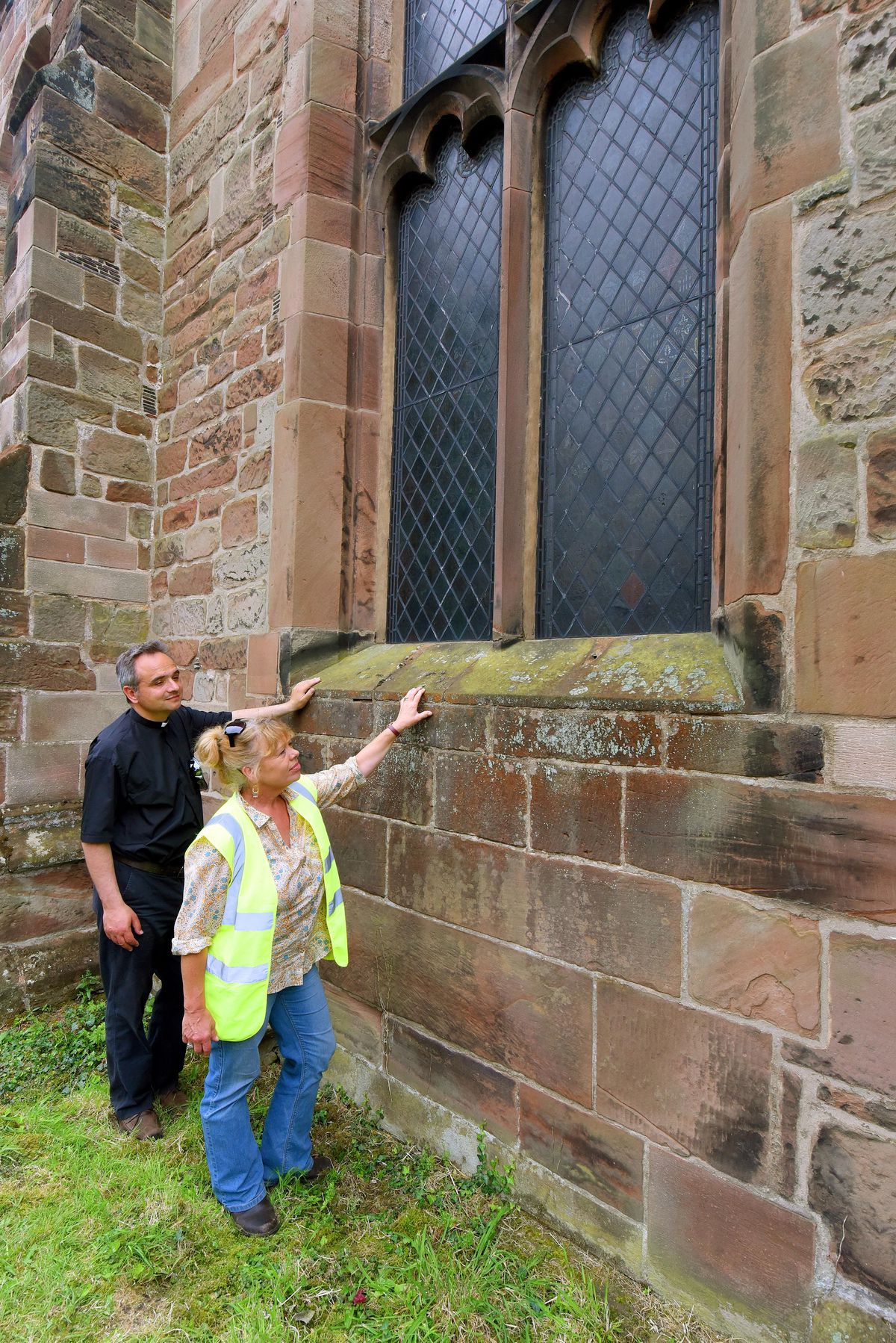 Archaeology dig at St Michael's and All Angels Church, Penkridge. Rev Greg Yerbury and heritage consultant and director of Commercial Archaeologists Helen Martin-Bacon, next to what used to be the original entrance to the church.