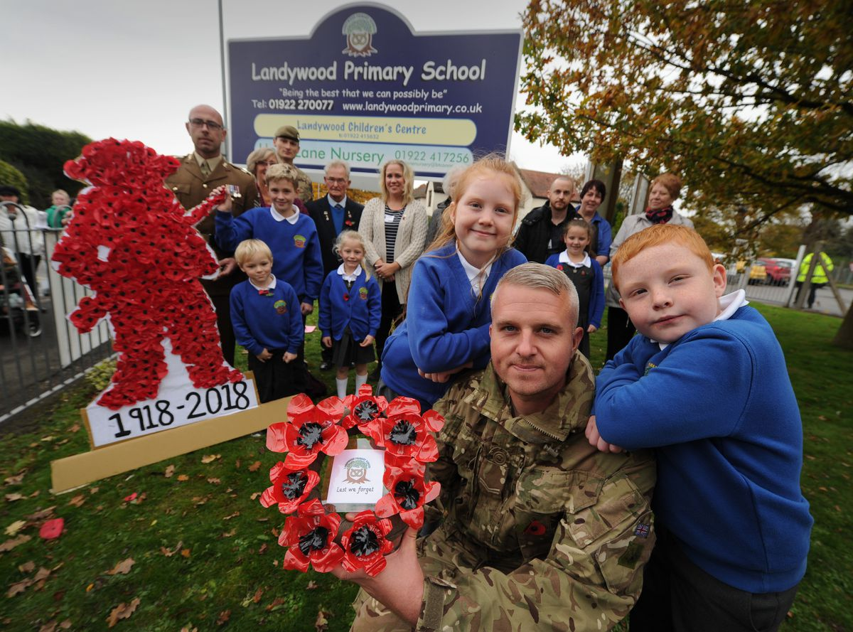A Remembrance event took place at Landywood Primary School, great Wyrley, including serving soldier Steven Boyle with his children pupils Scarlett Boyle, nine, and Reece Boyle, six, all of Cheslyn Hay