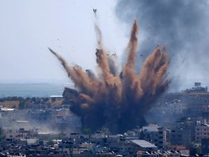 Smoke rises following Israeli air strikes on a building in Gaza City