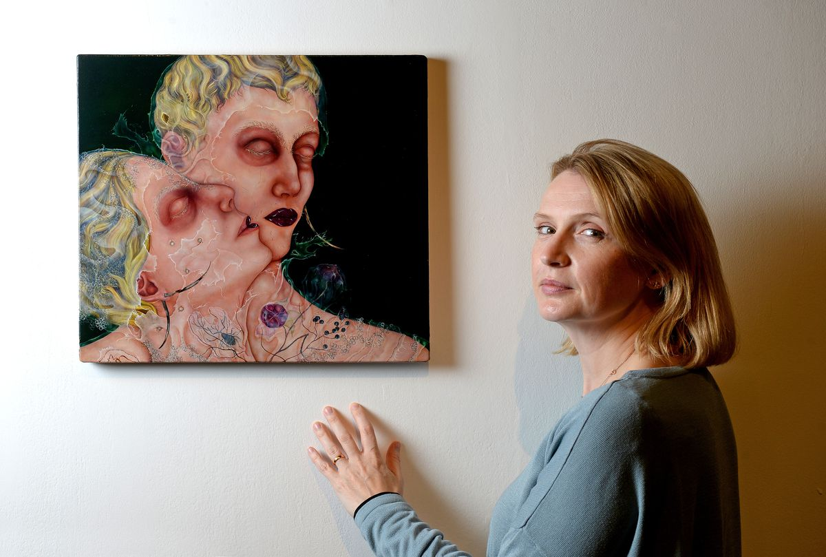 New Art gallery, Walsall, will reopen its doors to the public on Tuesday 18th May. They open with a major exhibition by renowned British painter Anj Smith. Pictured is exhibitions co-ordinator Hannah Anderson, next the one of the paintings on display called The Lover