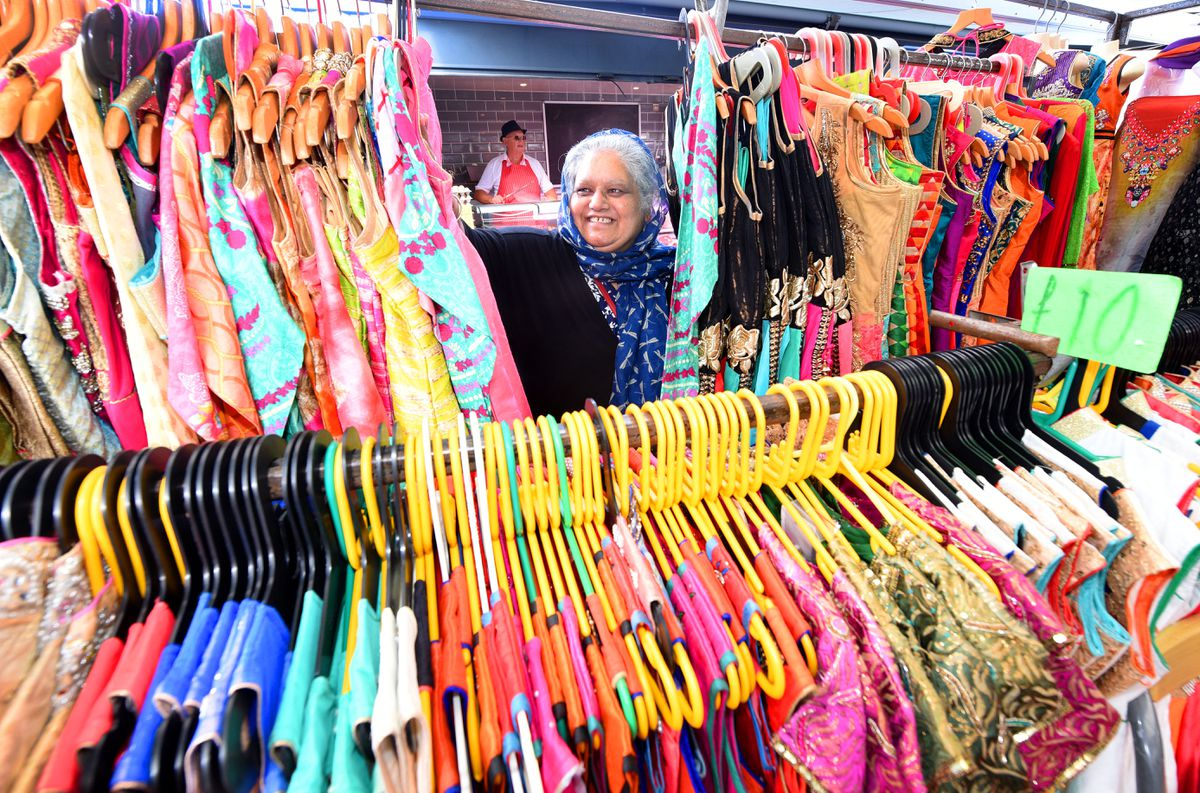 Neelu Kaur among the colourful clothes for sale