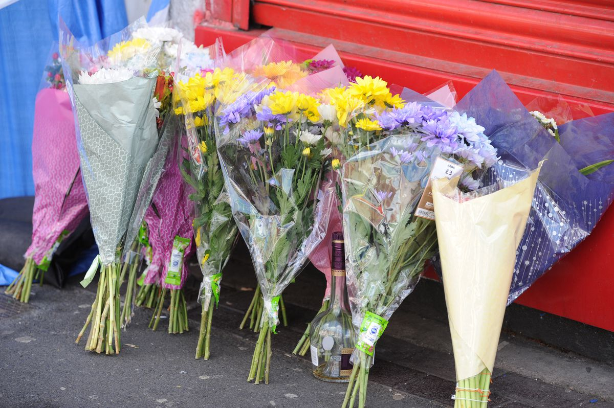 Floral tributes outside the Nowa Polka shop on Waterloo Road, Smethwick