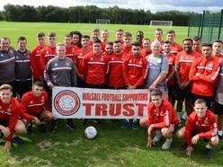 Walsall players make donation to supporters trust