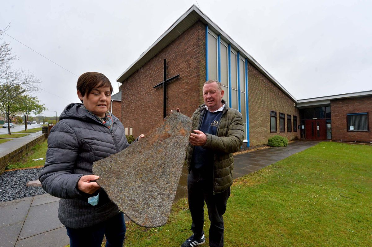 Sue Bate and Gary Bate with a section of roof from Lanesfield Methodist Church