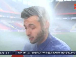 The moment the sprinkler system hit the reporter