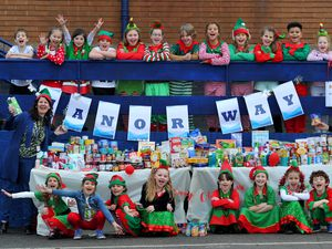 Pictured with the 'elves' are headteacher Lisa Buffery (right) and Lynne Tilby (left) from Black Country Food Bank