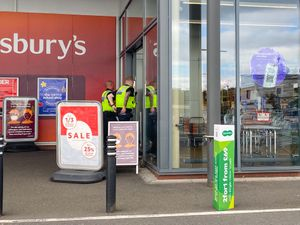 Police officers at Sainsbury's after the boy was bitten nearby. Photo: SnapperSK
