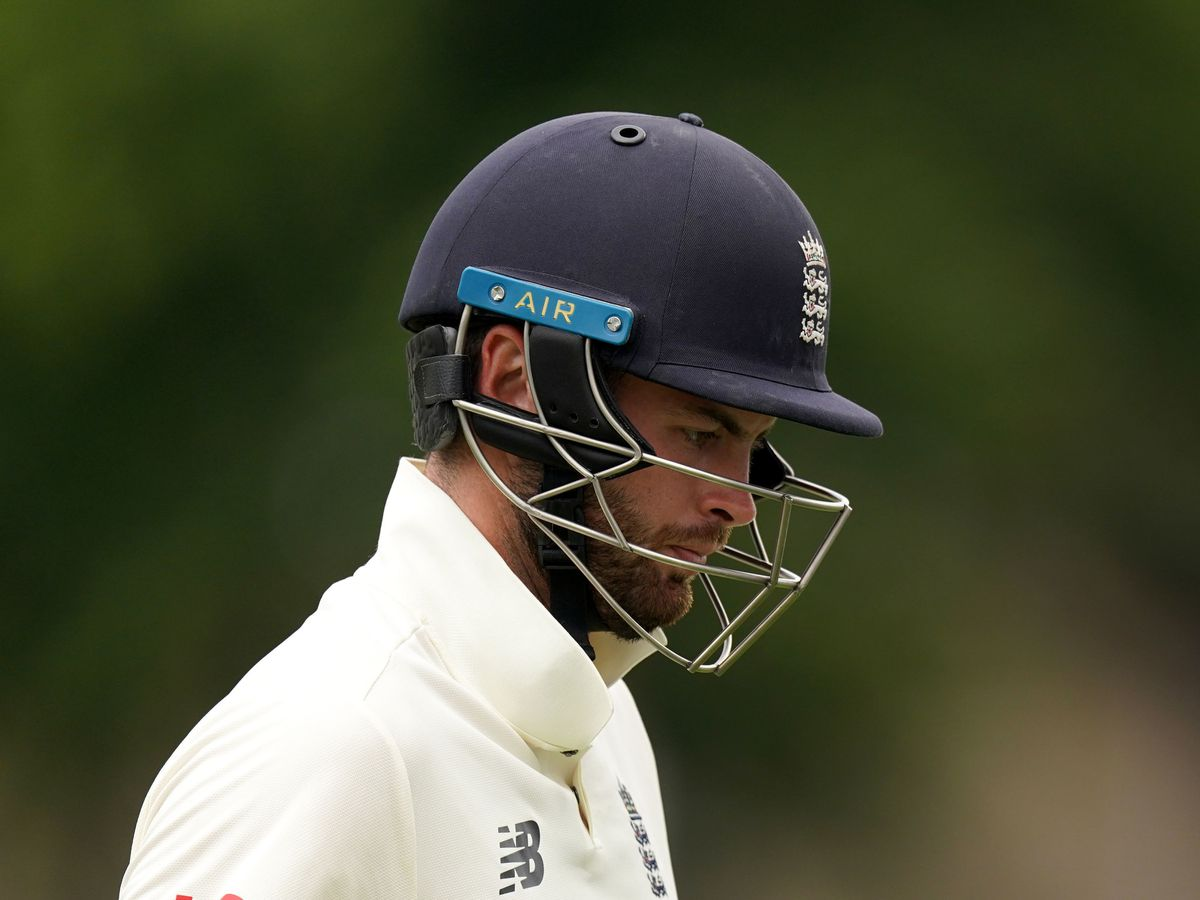 England's Dom Sibley walks off after being caught out.