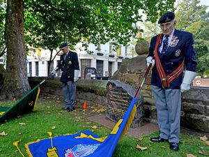 Members of a Royal British Legion branch pay tribute at St Peter's Square in Wolverhampton on Victory over Japan (VJ Day) last year
