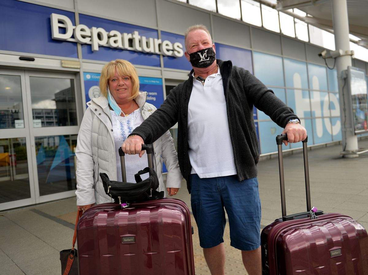 Holidaymakers Colin Briton and Julie Sarnaz at Birmingham Airport