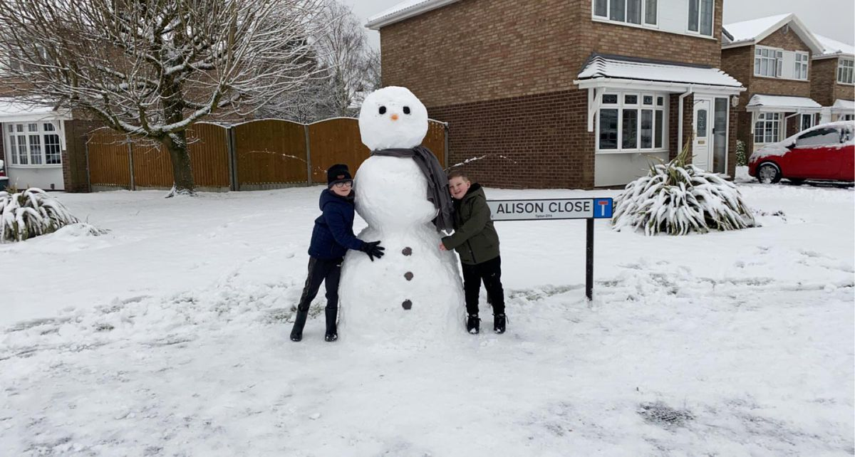 Frank Gardner and Ethan Hall had fun building a 6ft snowman in Tipton