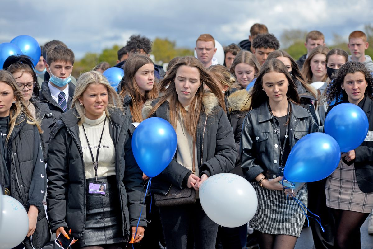 Friends gather at the balloon release