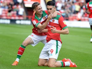 Conor Wilkinson celebrates the opening goal.