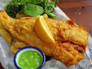 Classic fish and chips with mushy peas