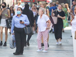 People wearing masks outdoors