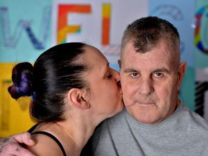 A welcome home kiss for Anthony Vincent from wife Suzette