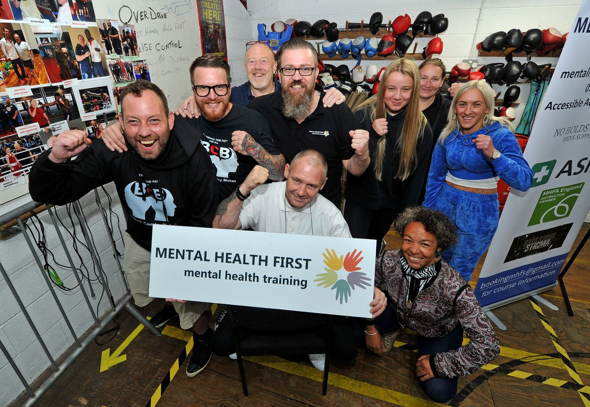 Pictured is head coach Kev Dillon( left) with Ian Hines(seated) and Matt Hartill(centre standing) from Mental Health First, and other members of the boxing club..