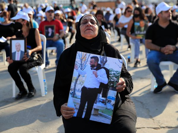 Grieving and angry Lebanese mark year since horrific blast