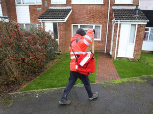 A Royal Mail delivery worker in Ashford, Kent, during England's third national lockdown to curb the spread of coronavirus