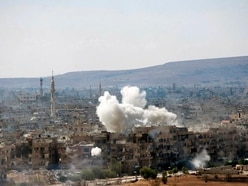 Syrian government forces pound Islamic State-held districts of Damascus