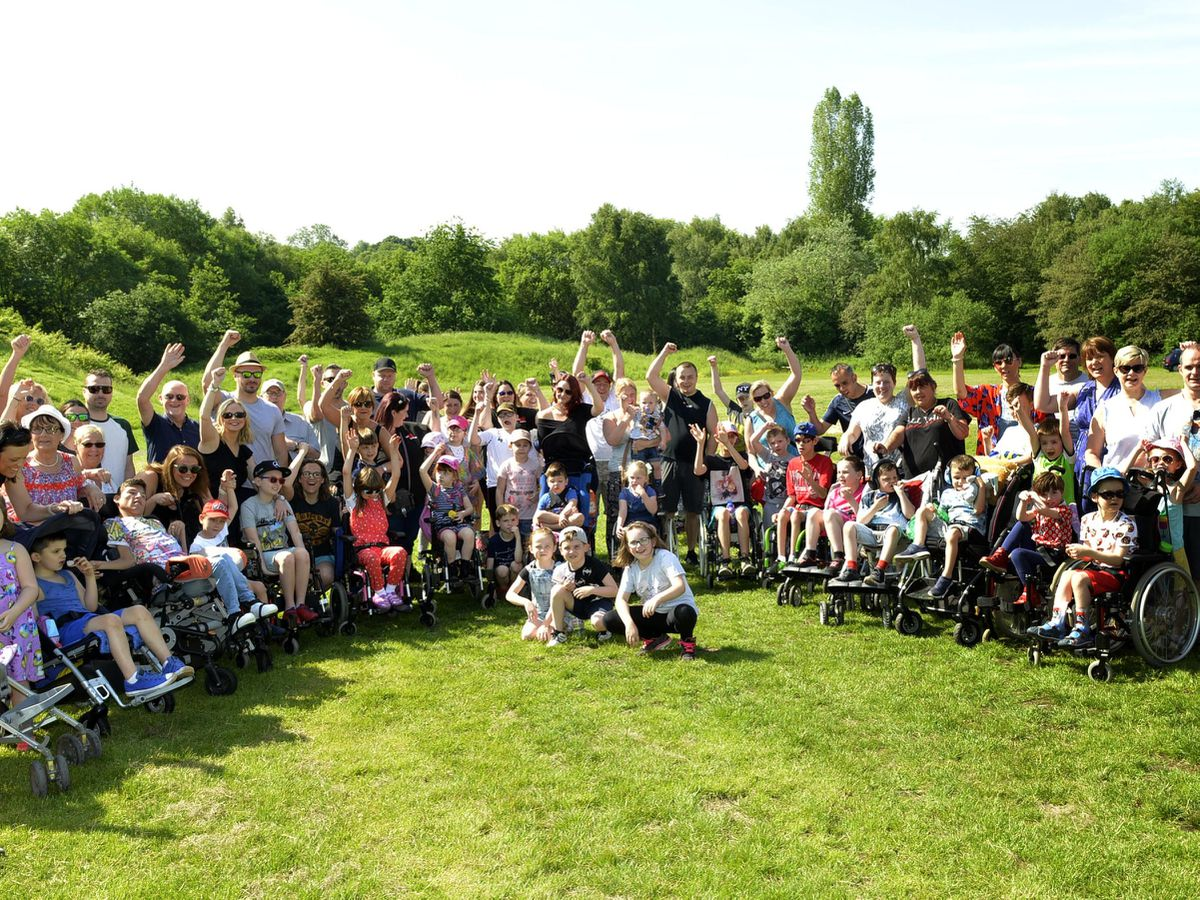 Dozens of families took part in a walk to raise money to challenge Dudley CCG