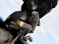 Spacewalkers succeed in finding mystery hole in capsule