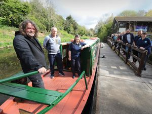 With the restored narrowboat, (left-right) former Goodyear workers Keith Garrett, Mark Jenkins, with senior volunteer Liz Hoggarth, at Wildside Activity Centre, Wolverhampton
