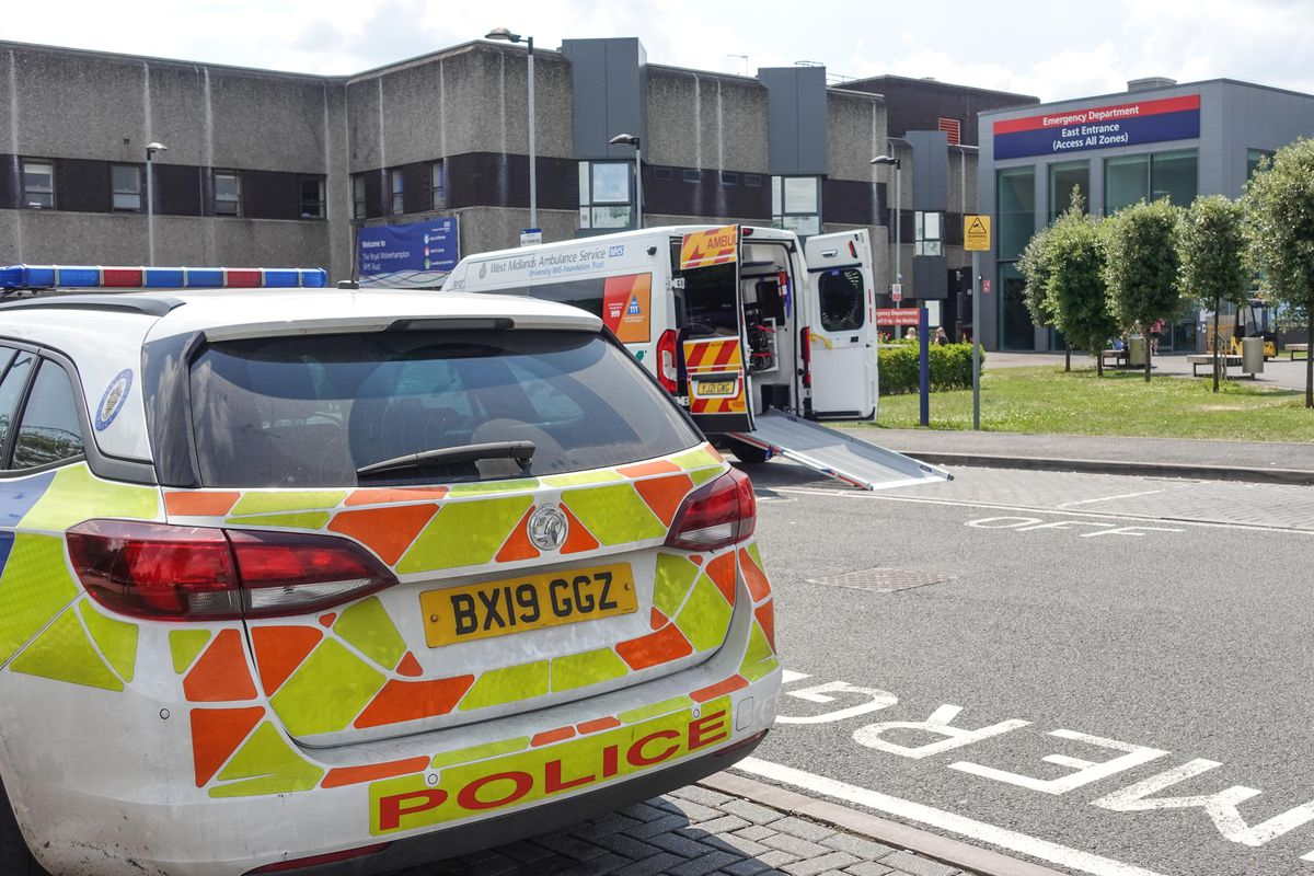 Police at the Emergency Department entrance of New Cross Hospital in Wolverhampton after a member of staff was stabbed. Photo: SnapperSK.