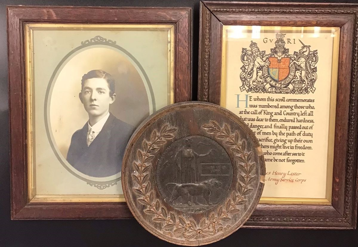 A picture of James Lester, alongside his death plaque and certificate