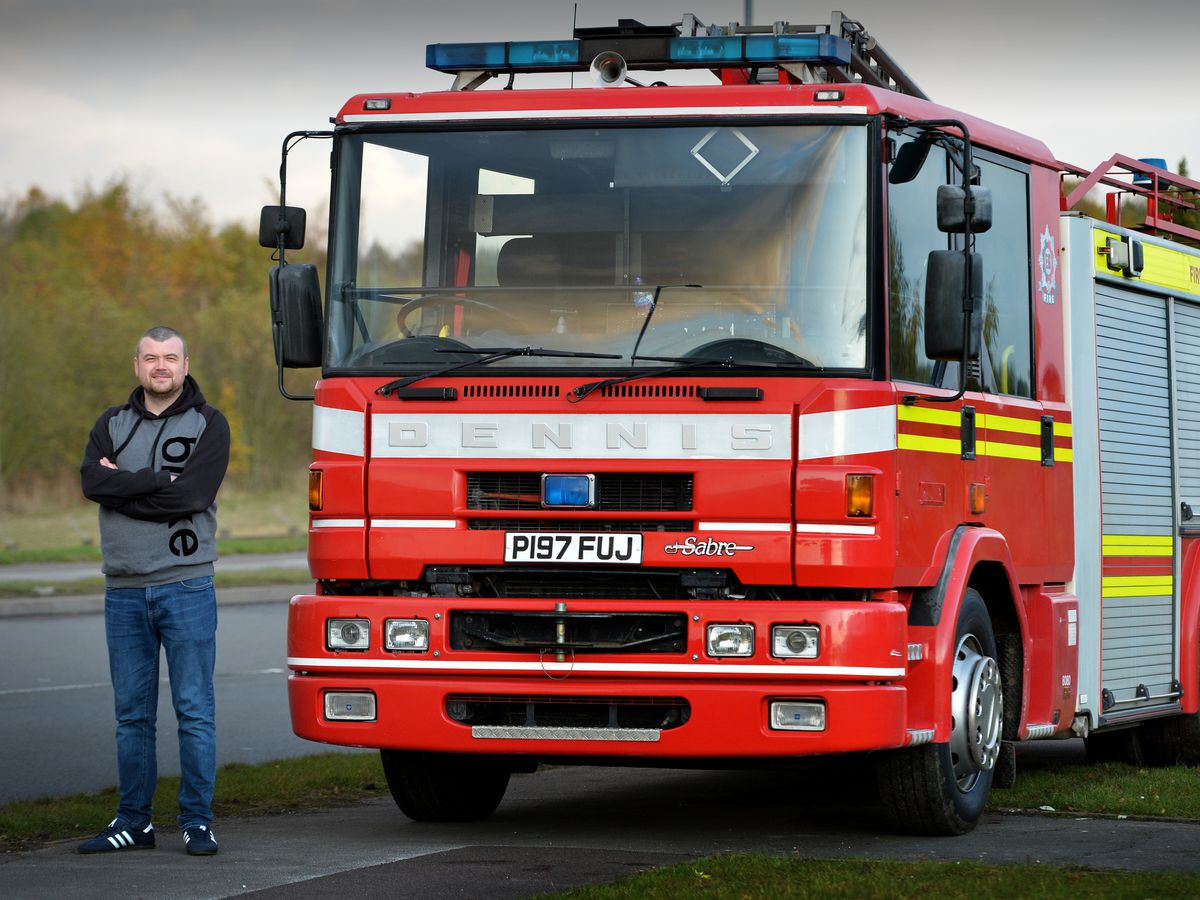 Lawrence Garbett with his fire engine
