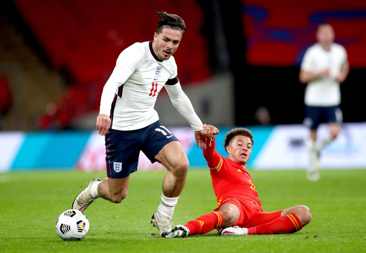 England's Jack Grealish (left) and Wales' Ethan Ampadu battle for the ball