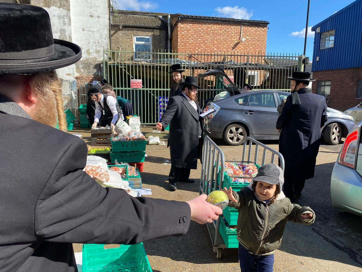 Jewish volunteers distribute food packages to families ahead of Passover