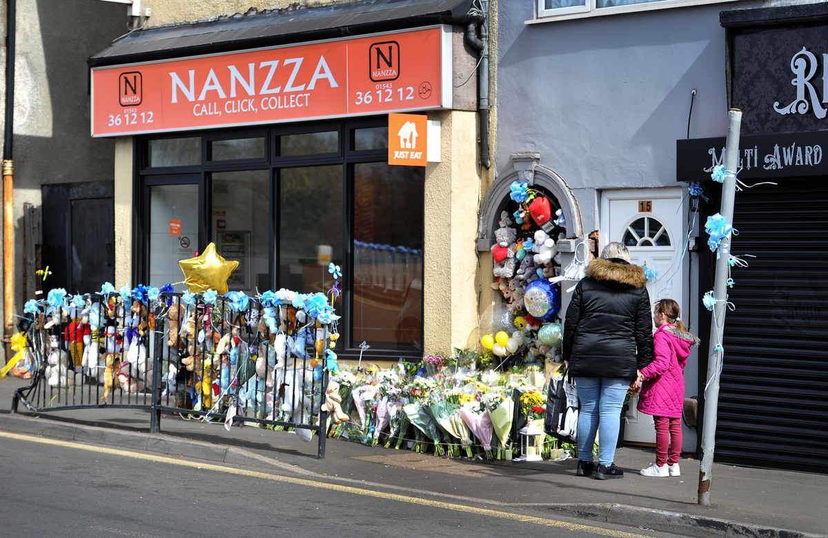 Floral tributes at the scene where two-week-old baby Ciaran Leigh Morris was killed in a crash