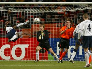 BRITISH VASSELL SCORES DURING FRIENDLY SOCCER MATCH BETWEEN THE NETHERLANDS AND ENGLAND...England's Darius Vassell equalizes with a bycicle kick during in the Amsterdam Arena February 13, 2002. England tied Holland 1-1 in a friendly match in preparation for the World Cup 2002 in Korea and Japan.REUTERS/Paul Vreeker
