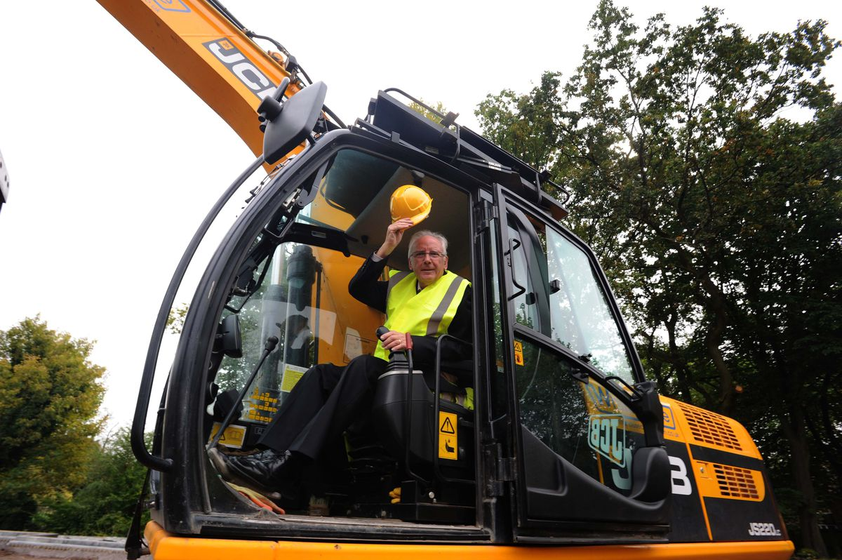 Pete Waterman gets started on the foundations of Dudley College's new Dudley Advance Engineering and Construction Centre in Priory Road, Dudley, in 2013