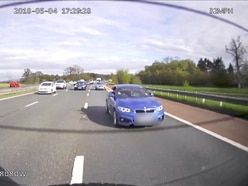 BMW driver gets six points on licence after waving arms out of window