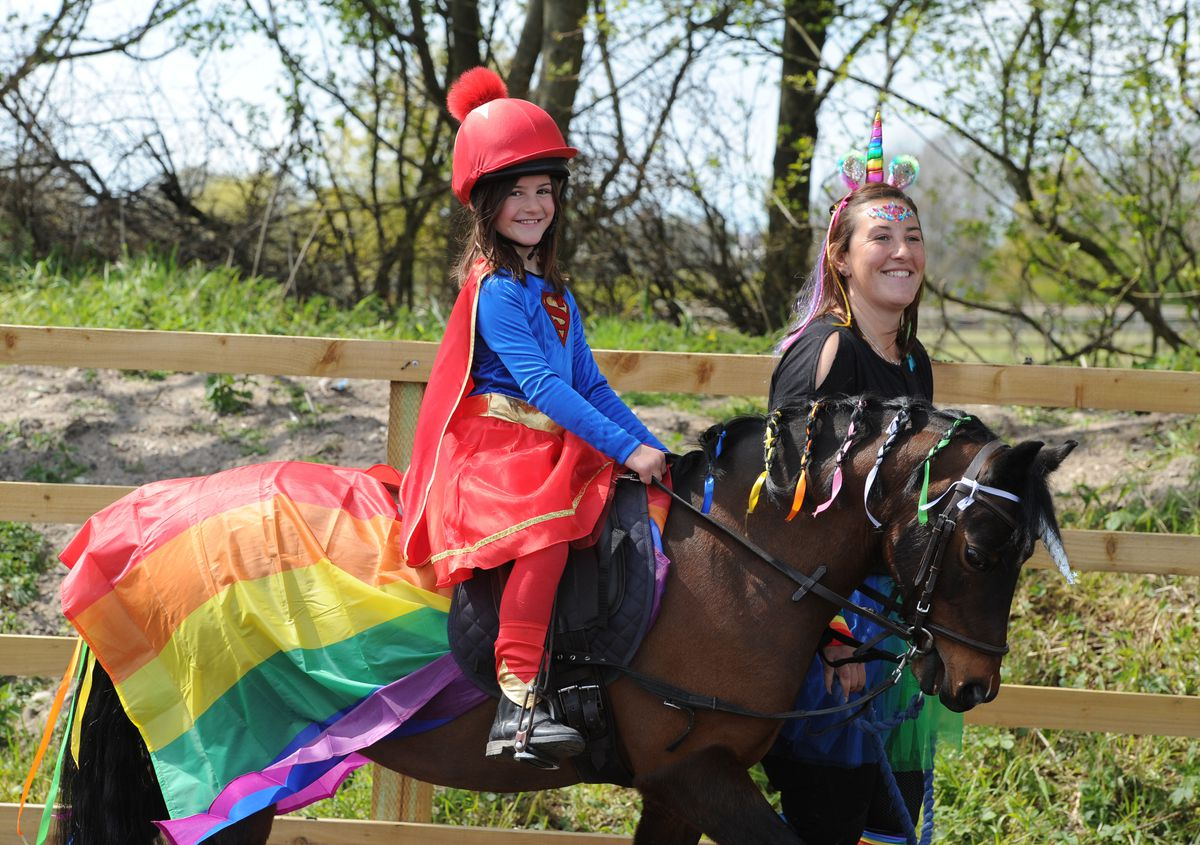 Taking part in a fancy dress fundraising riding challenge, at Norton Hall Farm and LAW Equine, Norton Canes