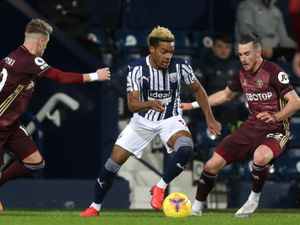 Grady Diangana of West Bromwich Albion gets between Ezgjan Alioski of Leeds United  and Jack Harrison of Leeds United.