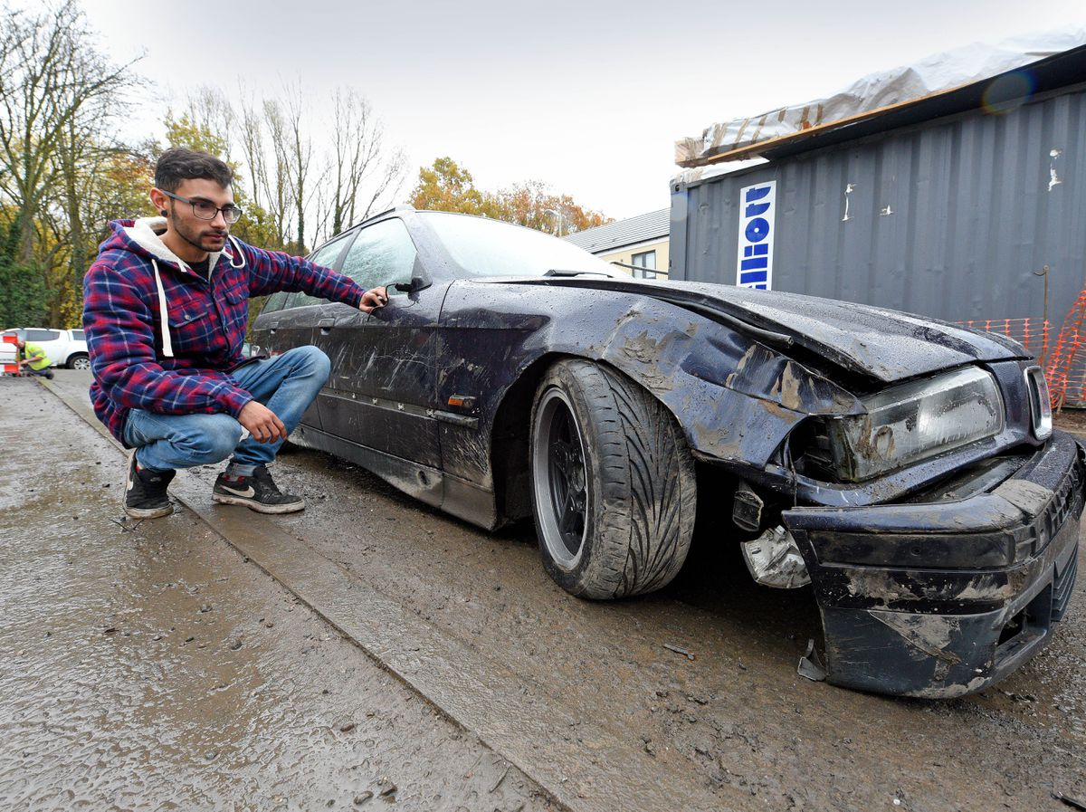 Tyler Hambly, from new housing estate Doultons Meadow, Netherton, who had his BMW trashed after thieves stole a digger from the nearby construction site which collided with his car during their getaway
