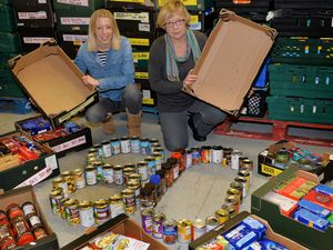 Jen Coleman and Sheila Wrigley with boxes filled with the items they would like donated